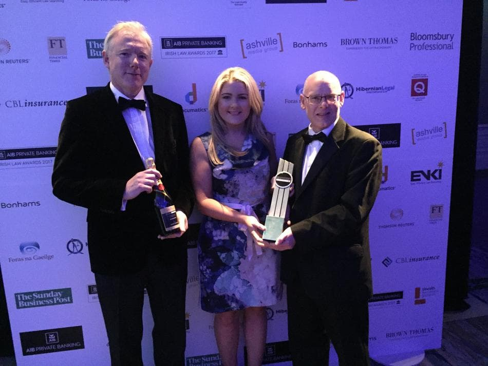 Two members of Beauchamps employment team accept their award for Employment Team of the Year at the AIB Private Banking Irish Law Awards 2017 from presenter