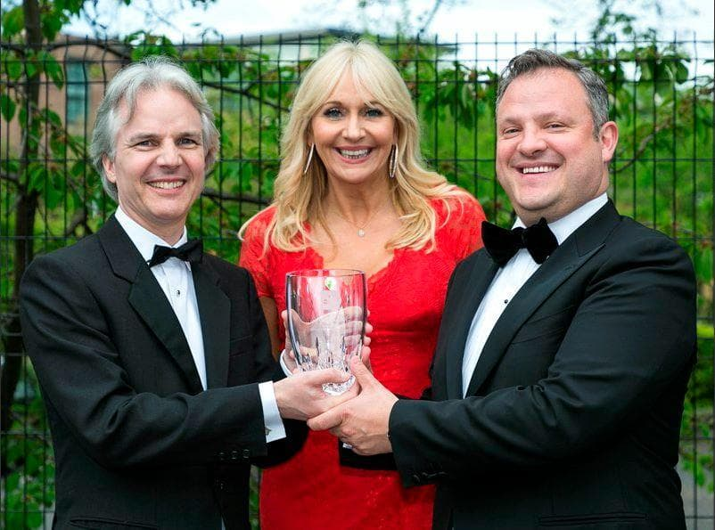 Tom Clinch, Miriam O'Callaghan and John White posing with award at the Irish Law Awards 2018